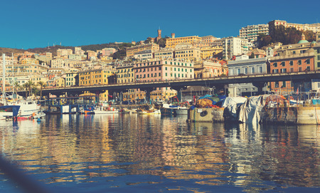 Famous Old Port on shore of bay in central part of Italian city of Genoa