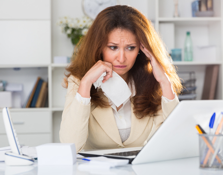 Woman is upset because of complicated issue with project in the office.