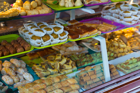 Variety of oriental sweets and bakery products on counter