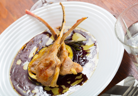 Roasted mutton ribs served with baked eggplant and wine sauce Archivio Fotografico