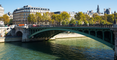 View of Pont Notre-Dame across Seine linking right bank of Paris with Ile de la Cite, France