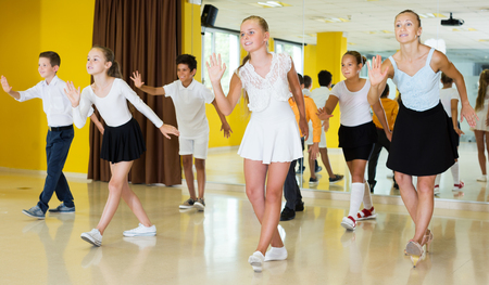 Active young emotional children  posing at dance  class