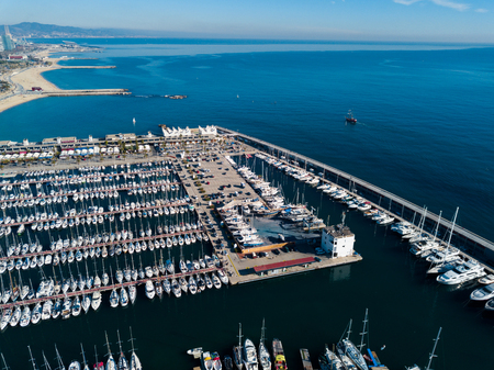 View from drone to boats and yachts in one of ports of Barcelona, Spain