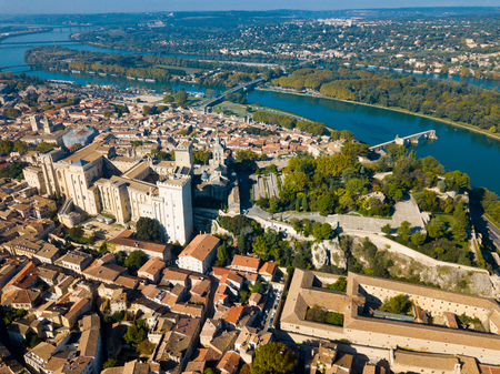 Aerial view of Avignon on bank of Rhone river with Palais des Papes in sunny autumn day, France