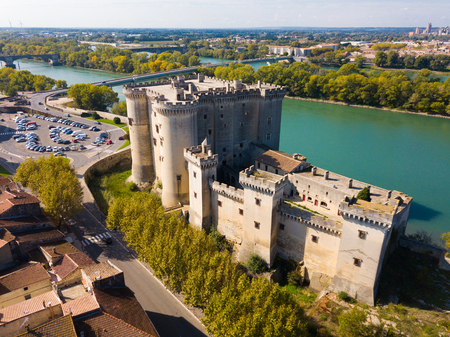 Aerial view of medieval fortified Chateau de Tarascon and Rhone river at sunny day