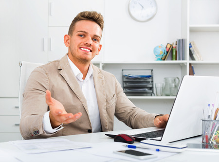 Portrait of  glad businessman working in modern office Stock Photo