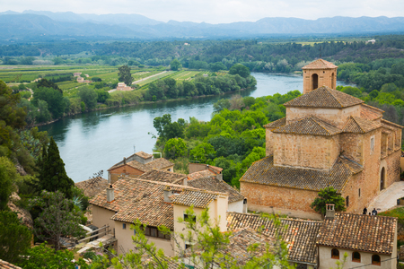 Ancient church in Miravet located along the blue river n Spain Stock Photo