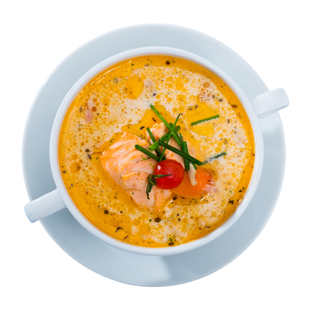 Picture of  delicious soup with salmon, served in white bowl at table.  Isolated over white background Stock Photo