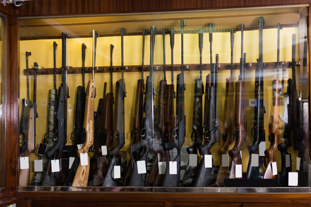 Gun store interior with specialized rifles on showcase
