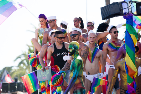 SITGES, SPAIN – JUNE 19, 2016: cheerful people wearing bright makeup and costume on pride parade in Sitges, Catalonia