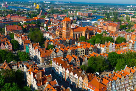 Aerial view of summer cityscape of Gdansk with tower of Gothic Church of St.John, Poland