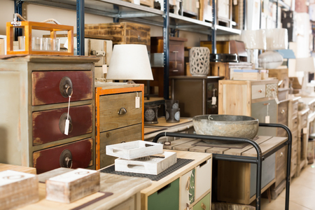 Old design furniture goods offered for sale in furnishings showroom