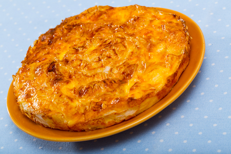 Traditional dish of Bulgarian cuisine – Banitsa. Whisked eggs and pieces of cheese between pastry