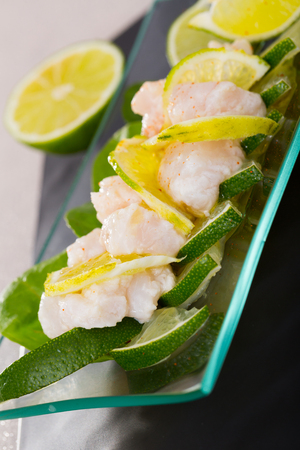 Freshly prepared Ceviche. Recipe - finely chop 200 gr. fillets of pollock, 1 clove of garlic, onion and jalapeno, season with lime juice and salt Banco de Imagens