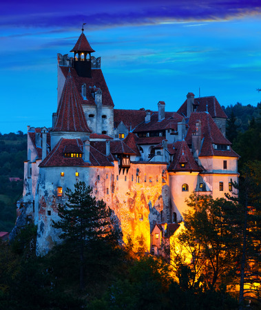 Impressive landscape with famous Bran Castle in evening dusk, Romania Stock Photo