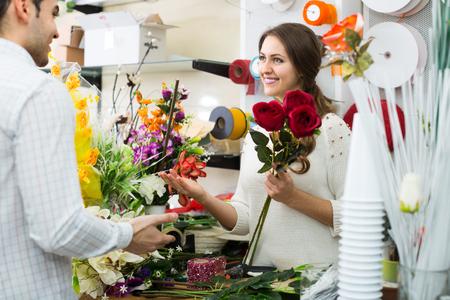 smiling american woman seller offering flowers