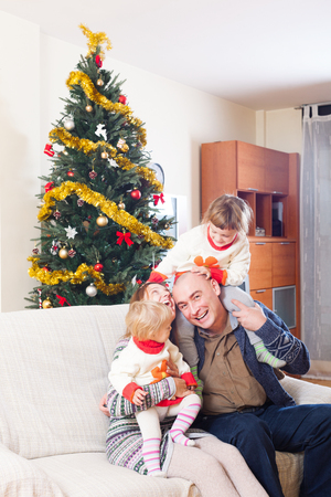 happy smiling family with Christmas tree at home