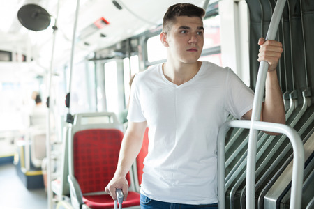 Portrait of modern male passenger in T-shirt traveling in bus Stock fotó