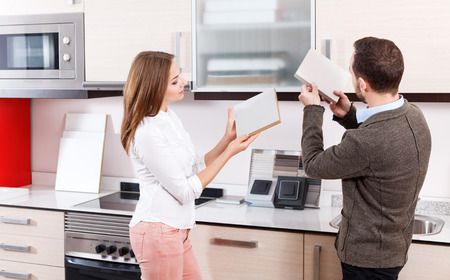 Married couple looking for stylish materials for kitchen furnishing in store Stok Fotoğraf