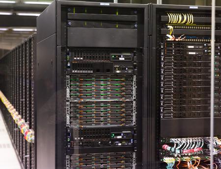 BARCELONA, SPAIN - JANUARY 16, 2018: Rows of modern server racks of Barcelona Supercomputing Center Reklamní fotografie - 116827340