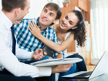 Family and banking agent discussing possibility of mortgage