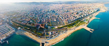 Aerial view of seaside area of Barcelona with harbor on sunny day, Catalonia, Spain