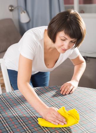 Cheerful woman doing housework – washing kitchen Stock Photo