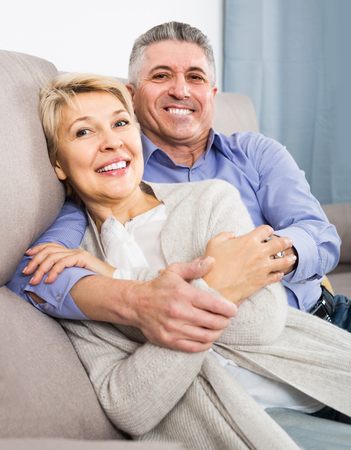 Mature married couple understand and love each other and are happy in house