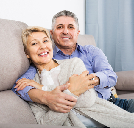 Mature russian married couple understand and love each other and are happy in house