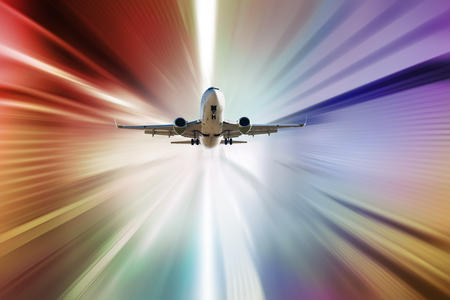 Big airplane taking up motion in sky on sunbeams background Banco de Imagens