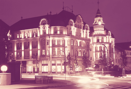 View of architectural hotel complex in Oradea in night, Romania Фото со стока