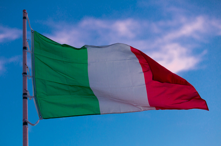 Image of national tricolour flag of Italy on flagpole at sky