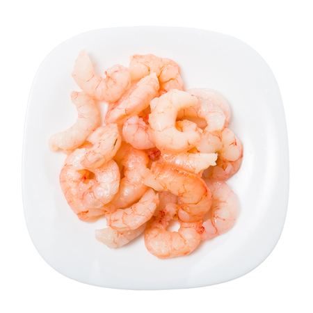 Plate of frozen shrimp isolated on white background