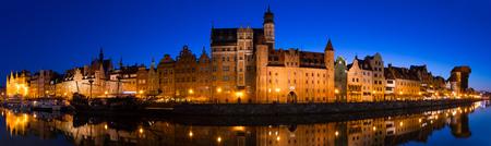 Nightlife of illuminated embankment of Motlawa river in Gdansk in summer, Poland