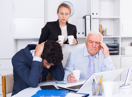 Mature man is having complicated issue with reports made by subordinates in office.