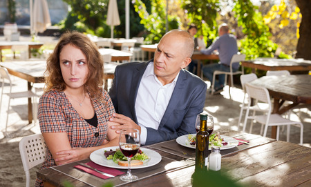 Family quarrel during lunch in an open-air restaurant