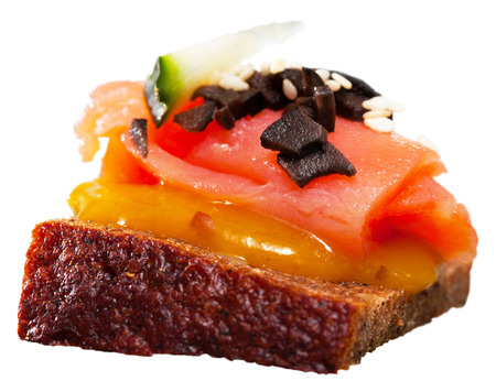 Delicious settee-bed with salmon fillet and spicy mango sauce. Isolated over white background
