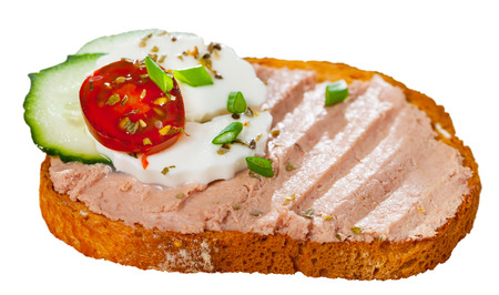 Sandwich with homemade chicken liver pate, green cheese and vegetables. Isolated over white background 免版税图像