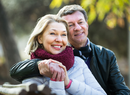 Portrait of happy mature spouses enjoying spending time outdoors at spring. Focus on woman 版權商用圖片