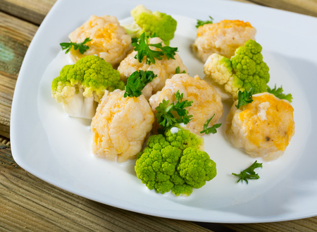 Dish of Norwegian cuisine  fish balls with tasty white fish served with  brokkoli at plate on table