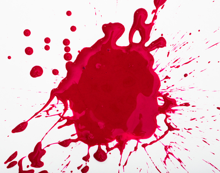 Closeup of shapeless bright red ink blot on white background