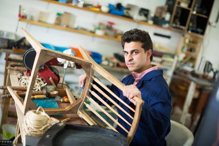 Carpenter working in repair studio and repairing broken wooden furniture Stock fotó - 115264485