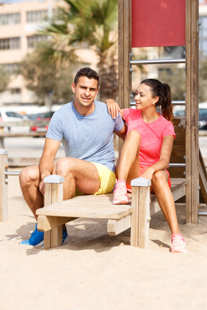 Lifestyle portrait of fitness friends going to exercise on outdoors workout Stock Photo