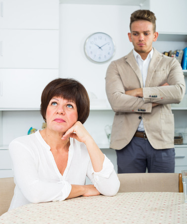 Son waits for his mother to take serious decision Stock Photo