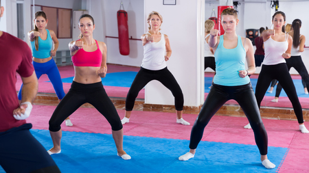 Womens group practicing self-defense with their coach in the gym Stock Photo