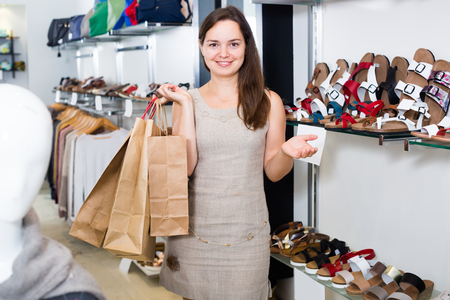 Portrait of young female  in footgear store