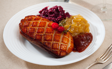 Plate of appetizing roasted duck breast Magret with marinated cabbage and rosemary Stock fotó