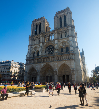 PARIS, FRANCE - October 10, 2018: View of impressive Cathedral of Our Lady (Notre-Dame) against blue autumn sky