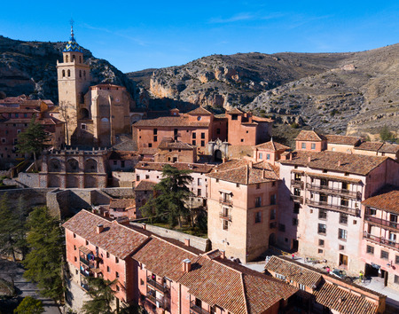 Aerial view of tiled housetops and defensive wall of medieval town Albarracin, Spain