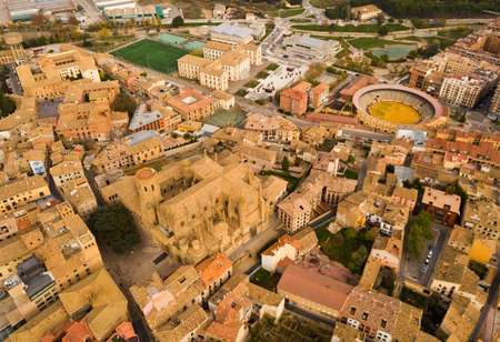 Smallish Spanish city of Huesca as seen from drone in autumn day